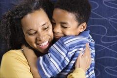 Woman Hugging Son royalty free stock photos