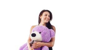 Woman hugging teddy bear Stock Photos