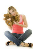 Woman hugging a Teddy bear, isolated Stock Image