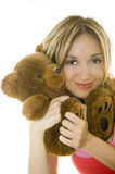 Woman hugging a Teddy bear, isolated Stock Photo