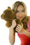 Woman hugging a Teddy bear, isolated Stock Photography
