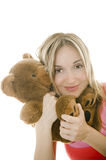 Woman hugging a Teddy bear, isolated Royalty Free Stock Photos