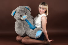 Woman hugging a teddy bear Royalty Free Stock Photography