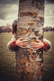 Woman hugging a tree Stock Image