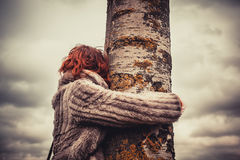 Woman hugging a tree Stock Images