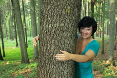 Woman hugging tree Stock Photography