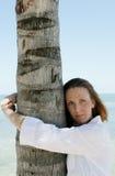 Woman hugging tree. Woman hugging a tropical palm tree, caucasian/white Stock Photos
