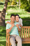 Woman huging her boyfriend Stock Photography