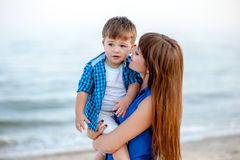 Woman hugs a boy. On the sea and have fun on a bright sunny day Royalty Free Stock Image