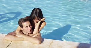 Woman hugs boyfriend and rests elbow on shoulder stock footage