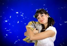 Woman hugs the pillow Stock Photos