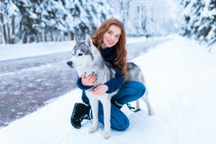 Woman hugs with siberian husky, friendship forever Royalty Free Stock Photos