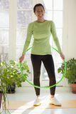 Woman with hula hoop Royalty Free Stock Photos