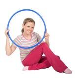 Woman with hula hoop Royalty Free Stock Photos