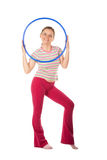 Woman with hula hoop Royalty Free Stock Images