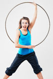 Woman with hula-hoop Royalty Free Stock Image