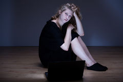 Woman humiliated by cyber bully Royalty Free Stock Photography