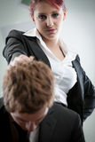 Woman humiliating a man on the workplace Stock Images