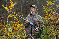 Woman hunter in camouflage on the riverside Royalty Free Stock Images