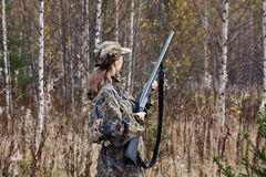 Woman hunter in the forest Stock Photos