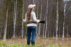 Woman hunter on the forest edge Royalty Free Stock Photography