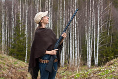 Woman hunter in forest Stock Photography
