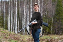 Woman hunter with gun Royalty Free Stock Photo