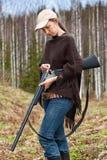Woman hunter loading shotgun Stock Photos