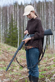 Woman hunter loading shotgun on the hunting Stock Photography