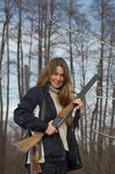 Woman hunter with two guns stock image