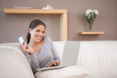 Woman hunting bargain online. Young woman hunting bargain online stock images