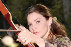 Woman hunting. With a bow Stock Images