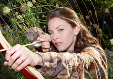 Woman hunting. Portrait of woman hunting with a bow stock photos
