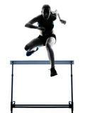 Woman hurdlers  hurdling  silhouette Stock Images