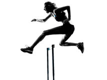 Woman hurdlers  hurdling  silhouette Royalty Free Stock Photography