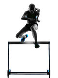 Woman hurdlers  hurdling  silhouette Royalty Free Stock Photos