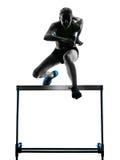 Woman hurdlers  hurdling  silhouette Royalty Free Stock Photos