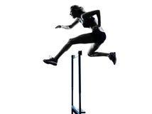 Woman hurdlers  hurdling  silhouette Stock Image