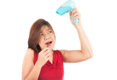Woman hurry up in the morning taking lip and hair dryer Stock Images