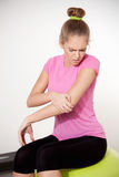 Woman with hurting arm Royalty Free Stock Image