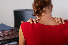 Woman with hurting back Stock Image