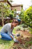 Woman husband working garden Royalty Free Stock Photos