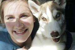 Woman with husky at home creative lighting stock image