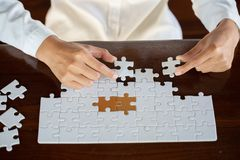Woman hWoman hands connecting couple jigsaw puzzle piece against sunrise, Business solutions, target, success, goals anbusiness. Business woman hands connecting royalty free stock image
