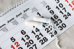 Woman hygiene protection , calendar close up.menstruation with cotton swabs used Royalty Free Stock Images