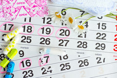 Woman hygiene protection , calendar close up.menstruation with cotton swabs , white daisies, Sanitary napkins on a light backgroun Royalty Free Stock Photo