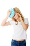 Woman with ice bag, having headache. Royalty Free Stock Photo