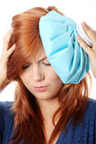 Woman with ice bag for headaches and migraines  Stock Images