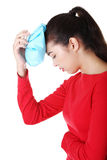 Woman with ice bag for headaches and migraines Royalty Free Stock Photos