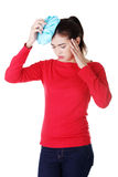 Woman with ice bag for headaches and migraines Royalty Free Stock Photography
